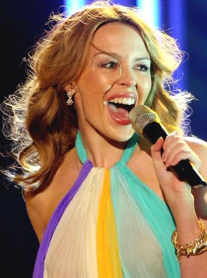 Kylie Minogue takes chauffeur driven limo ride for 75 metre journey