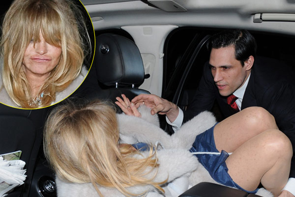 Goldie Hawn helped into her limo after partying till early hours in London