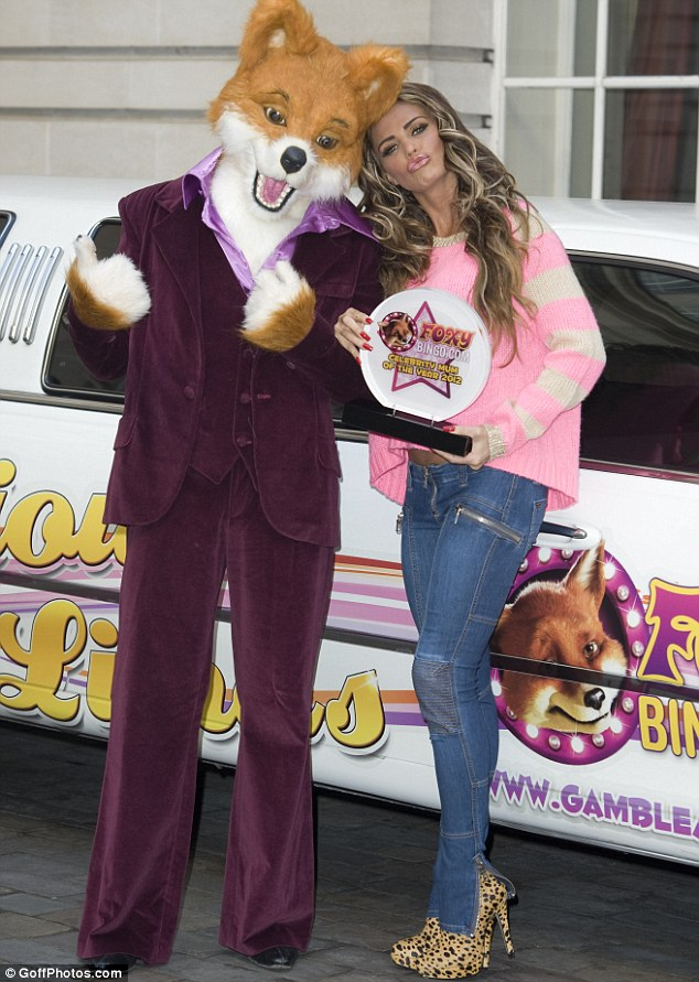 Katie Price poses next to Foxy Bingo Limo as she's named Celebrity Mum of the Year